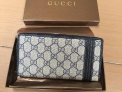 Authentic Gucci wallet like new wit Series number