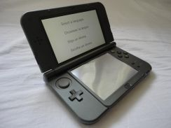 New 3DS XL (Black) + Free case + charger