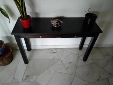 Elegant dark wood table for front entrance