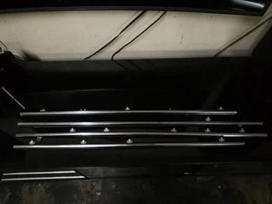 Toyota SEG - window down side chome.