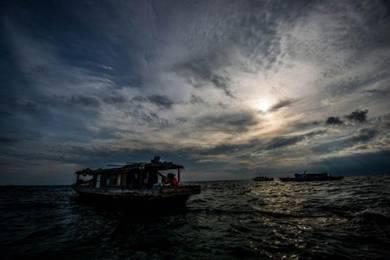 AMI Travel | At Mabul Island, Sabah