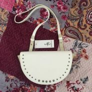 Studded sling bag by Something Borrowed