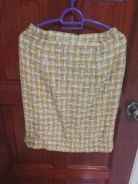 Yellow skirt for office wear