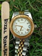 Aries gold 23k Quartz Swiss made