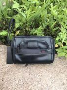 Tumi leather clutch organizer - COD KK on 6/10/18