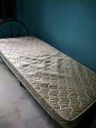 Single bed with foldable metal cot