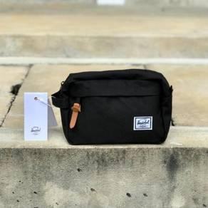 Herschel clutch bag blue black color