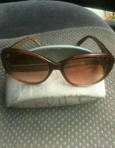 Calvin Klein sling bag & Calvin Klein sunglasses