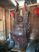 Wooden double sided Laughing Buddha