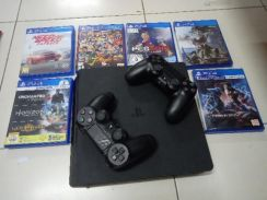 PS4 with joysticks and cds