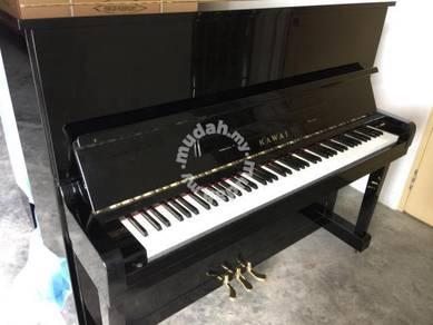 Kawai upright acoustic piano KU1-B