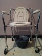 Mobile and foldable commode wheelchair