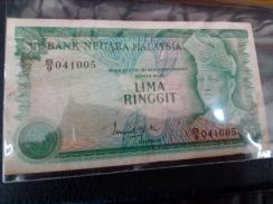 Duit RM5 lama gabenur Ismail Md Ali