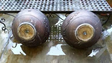 A pair of rustic look earthen pots