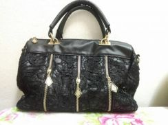 Black leather with lace handbag