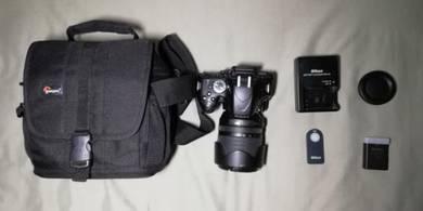 Nikon D5100 with 18~105mm lens