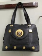 Gianni Versace hand bag black colour.