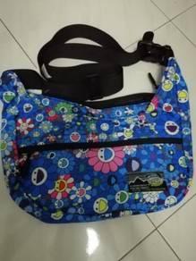 Duckdude sling bag floral design