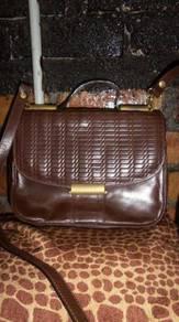 Pelco sling bags and handbags