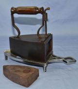 Vintage antique english slug iron with trivet