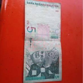 Duit RM5 kertas lama.