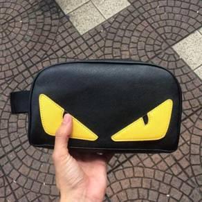 Unisex fendi yellow eyes clutch bag slingbag