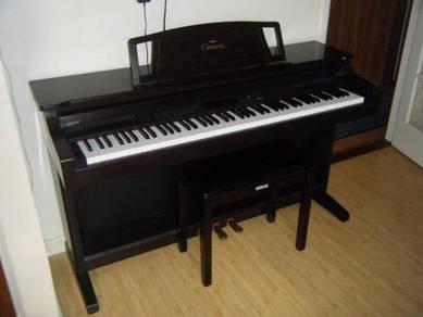 Yahama clavinova E150 electronic piano and stool