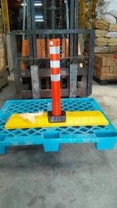 Plastic lane block with flexible post