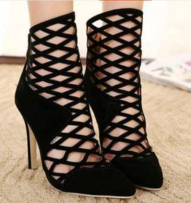 Black pointed high party heels shoe holes