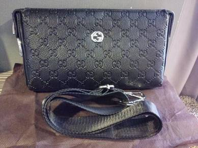 Gucci sling or clutch bag with lock