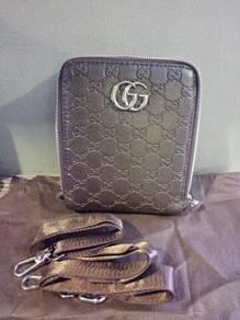 Gucci double zip sling bag