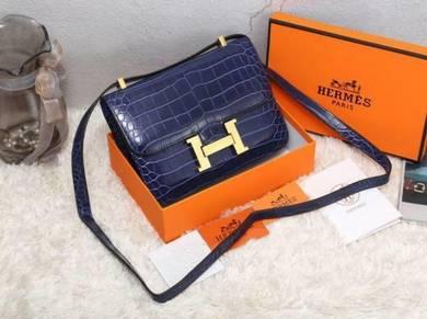 Elegant croc sling bag