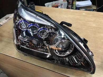 Toyota harrier mcu30 03-12 oem head lamp 3blue eye