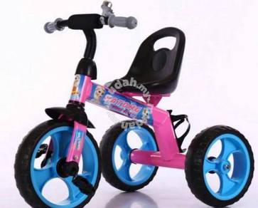 Pink childrend trycycle