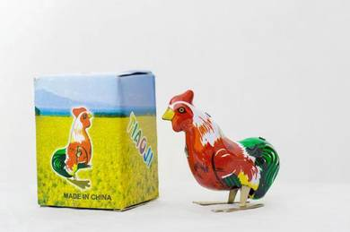 Vintage metal toy rooster, nostalgia old school