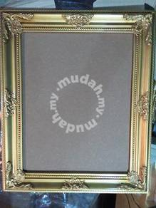 Gold ornate photo frames with wall hook