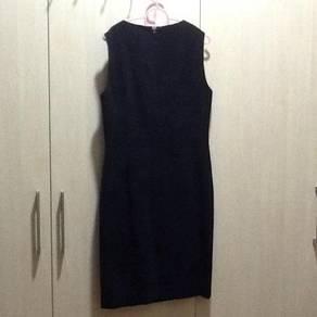 Black dinner dress by Edmund Ser