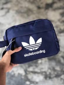Adidas skaterboarding blue clutch