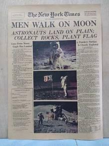 Men walk on moon newspaper poster