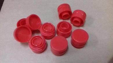Plastic punch in red cap