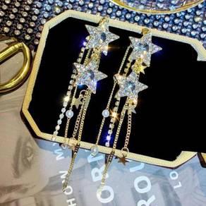 Gold plated diamond star long dangling earrings
