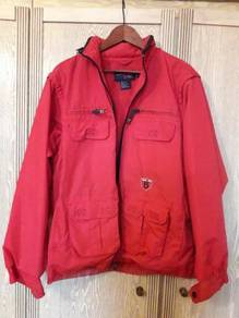 Jacket with hidden hood and removable sleeves
