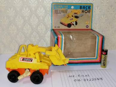 Back Hoe Wind Up Toot Toot Vintage no tin toy 80s