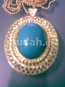 ABPGM-E002 Golden Metal Elliptical Blue G Necklace