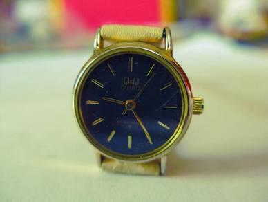 Q&Q Quartz Small Black Dial Watch