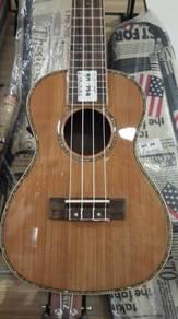 Full solid wood ukulele with seashell and pick up