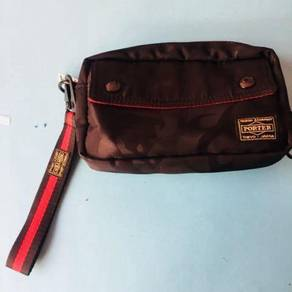 Porter clutch with strap