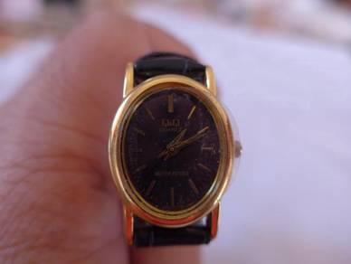 Q&Q Quartz Small Black Oval Dial Watch