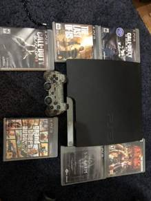 PS3 in good condition with video games