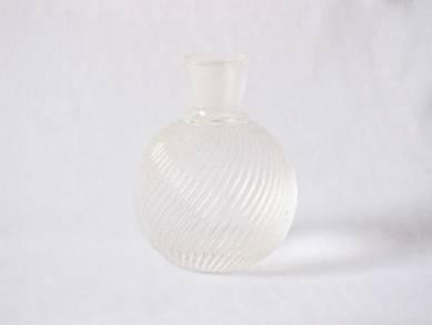 Grooved transparent glass bottle